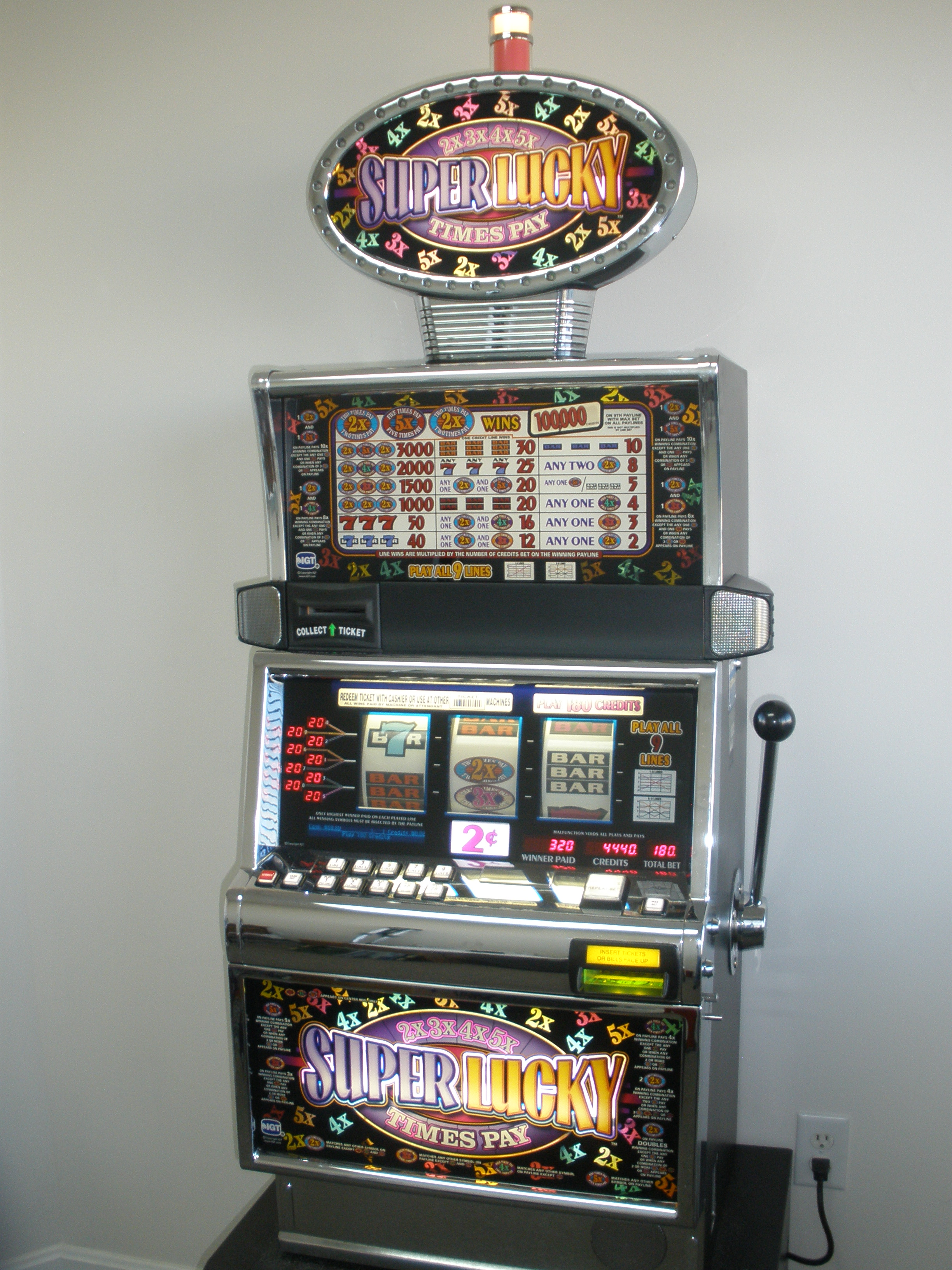 Slot Machines with Lighted Toppers