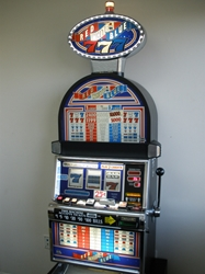 IGT RED, WHITE AND BLUE S2000 SLOT MACHINE WITH LIGHTED TOPPER AND QUARTER COIN HANDLING